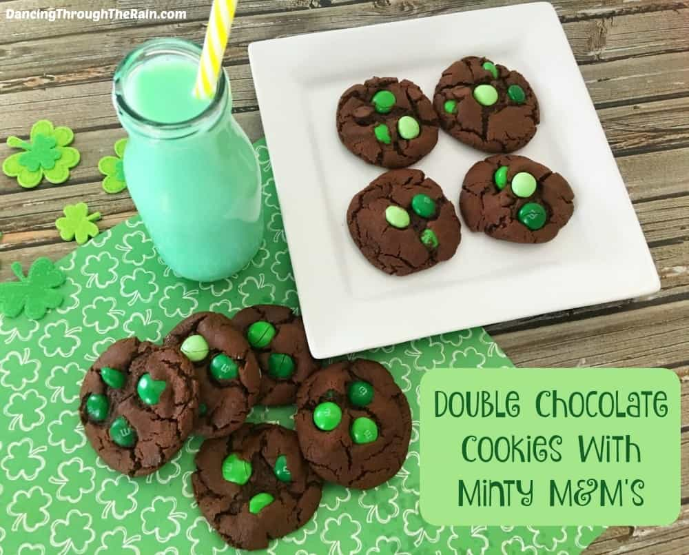 Double Chocolate Cookies with Minty M&M's on top of St. Patrick's Day placemat with green milk