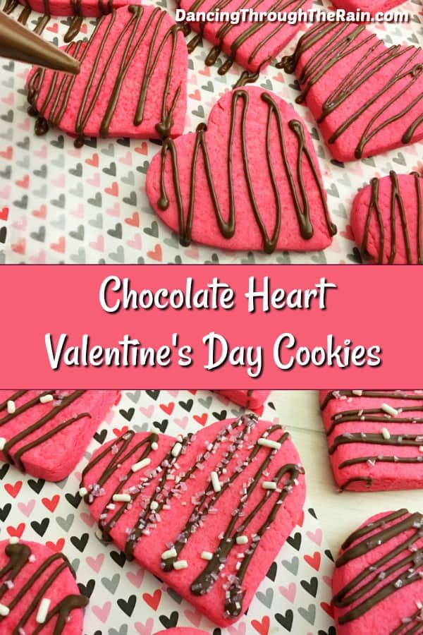 This is one Valentines day cookie heart that you can eat! These delicious pink heart cookies are perfect for Valentine's Day or any time of year that you are looking for edible gifts. With chocolate decorations and sprinkles, you will be able to show someone you love them! #heart #valentines #valentinesday #pink #cookies #ediblegifts