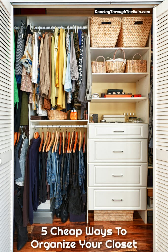 An organized closet with drawers, clothes hanging, and shelves with the words 5 Cheap Ways To Organize Your Closet