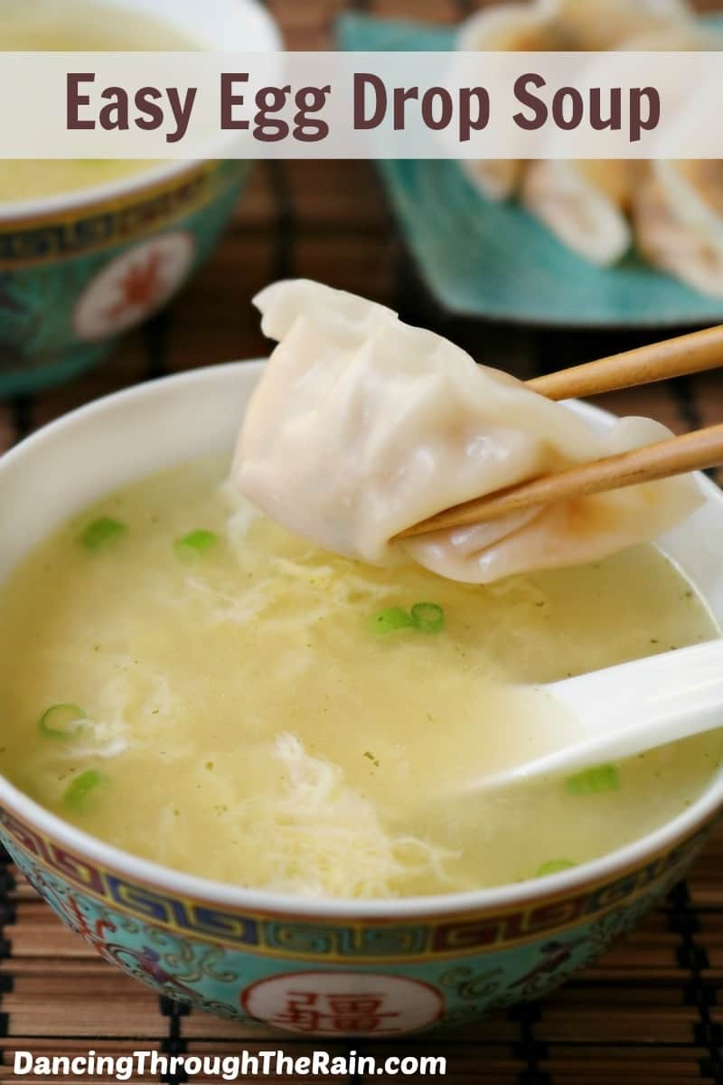 Easy Egg Drop Soup in a bowl with a dumpling held by chopsticks