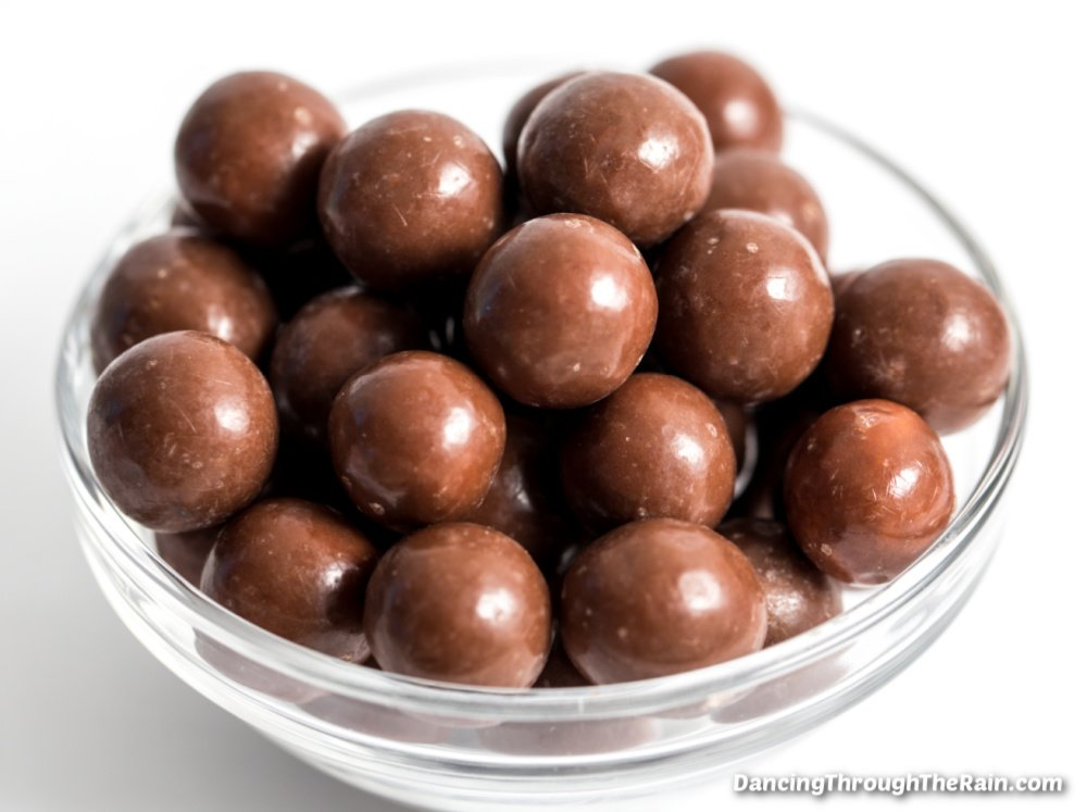 A clear bowl of Whoppers Candy
