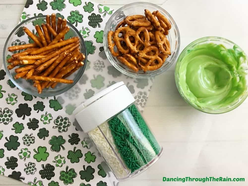 Pretzels, sprinkles, and melted green chocolate on top of a St. Patrick's Day placemat