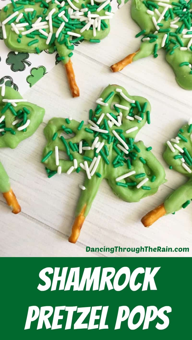 Shamrock Pretzel Pops decorated with green and white sprinkles on a table