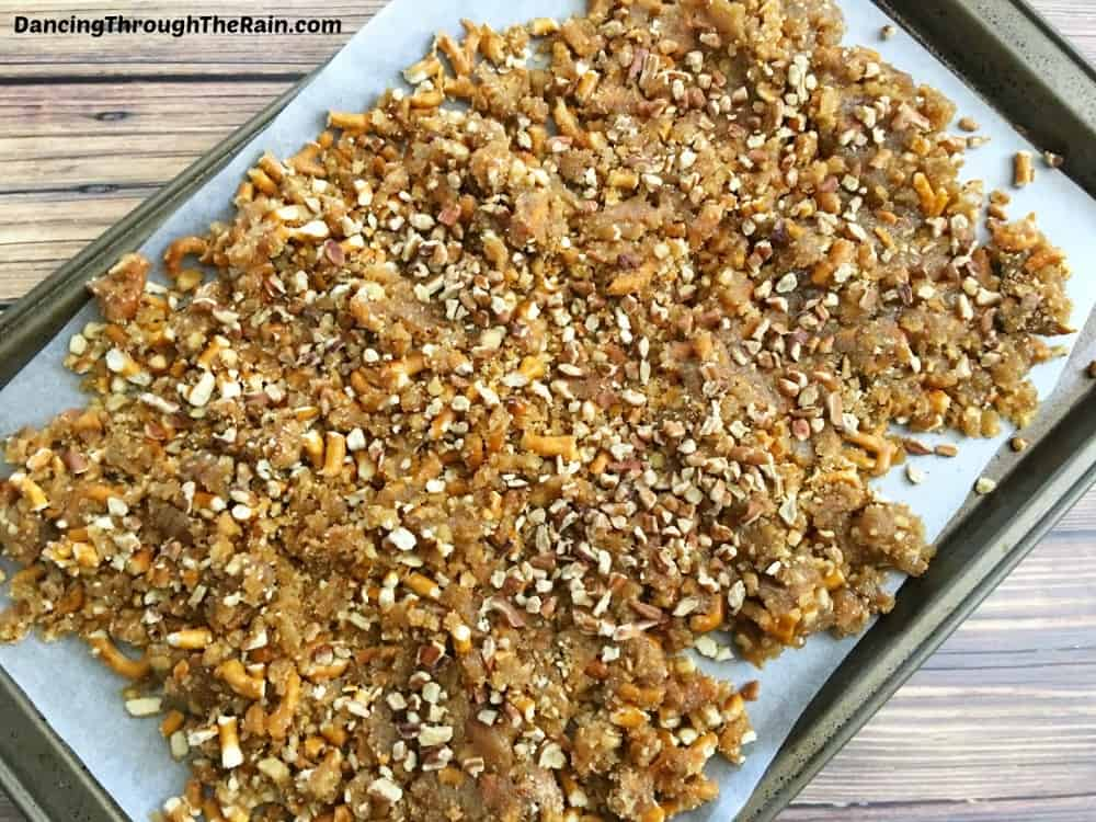 Crushed pretzels, brown sugar and pecans on a baking sheet
