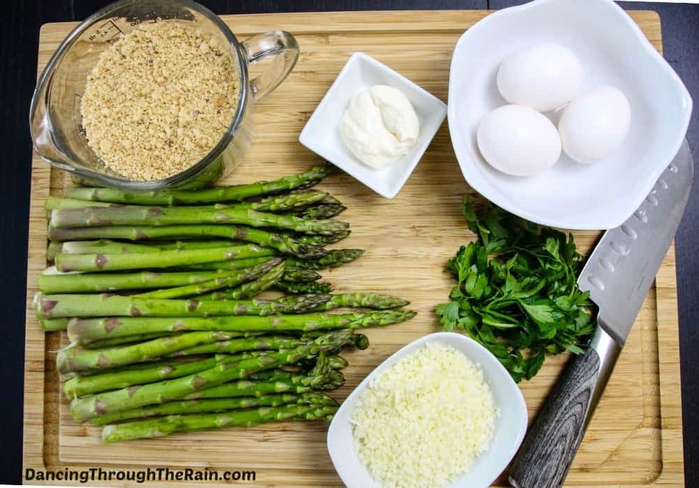 Ingredients for the Crispy Baked Asparagus Fries on a cutting board with knife