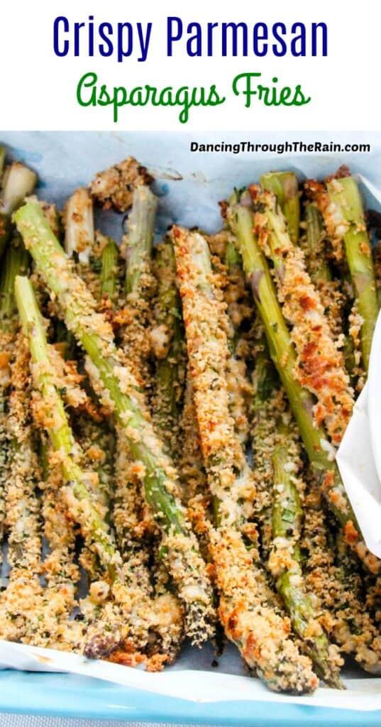 Crispy Parmesan Asparagus Fries on a blue tray with parchment paper underneath