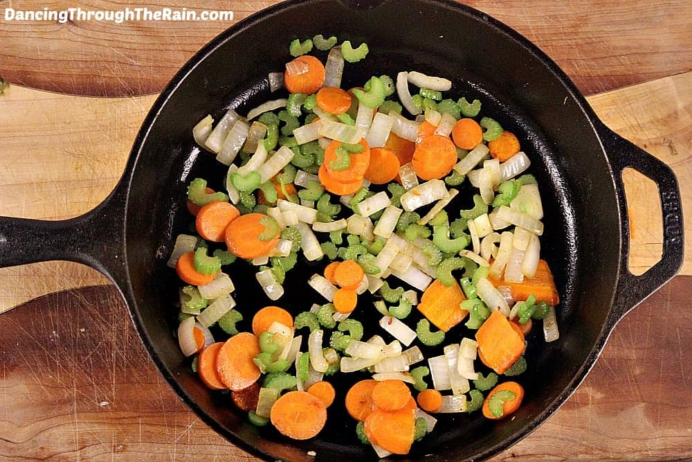 Chopped onions, carrots and celery in a cast iron pan