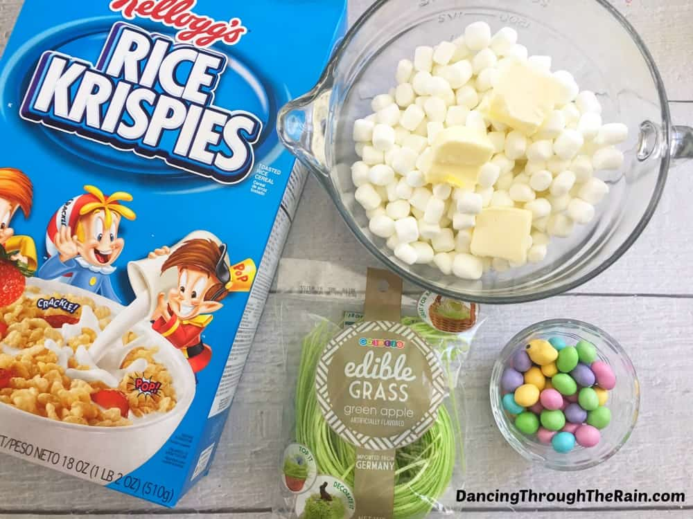 Ingredients for Rice Krispie Easter Nests: Rice Krispies cereal box, edible grass, candy eggs, marshmallows and butter