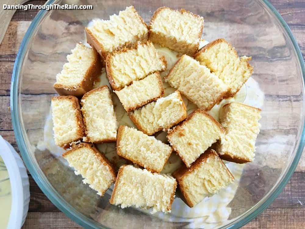Sliced pound cake inside a trifle dish