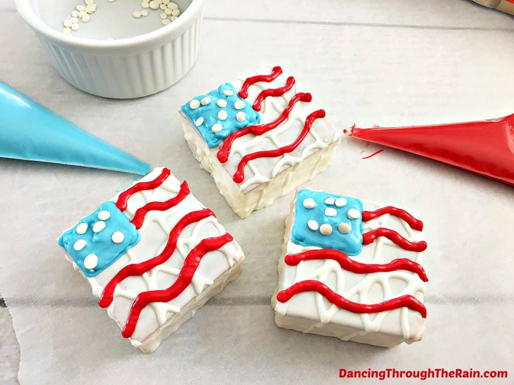 Patriotic Snack Cakes being decorated