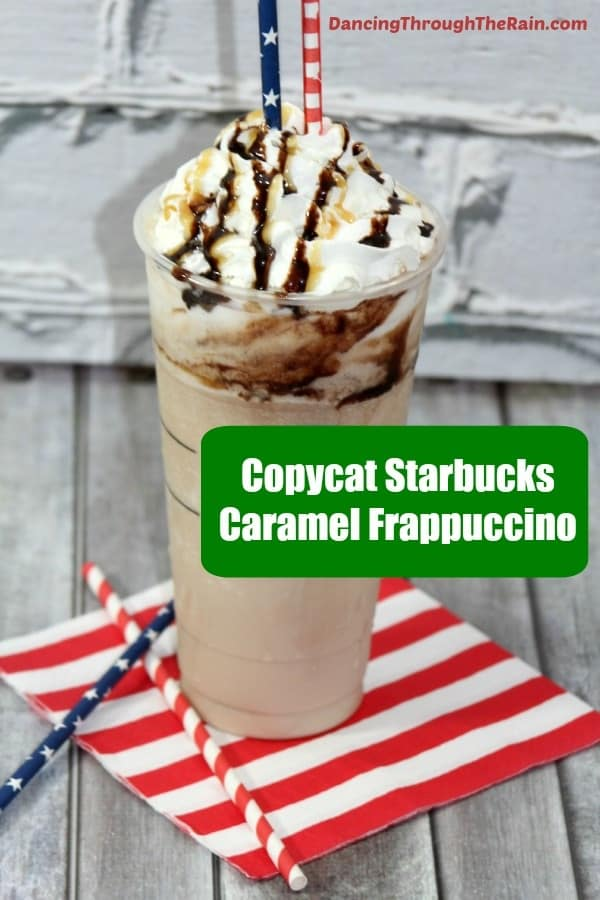 Caramel Frappuccino in a clear plastic cup with red and white striped and blue with white star straws sticking out