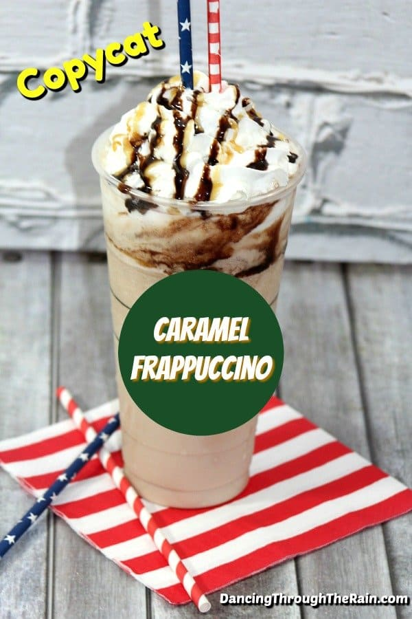 Caramel Frappuccino in a clear cup with red and white striped and blue and white starred straws