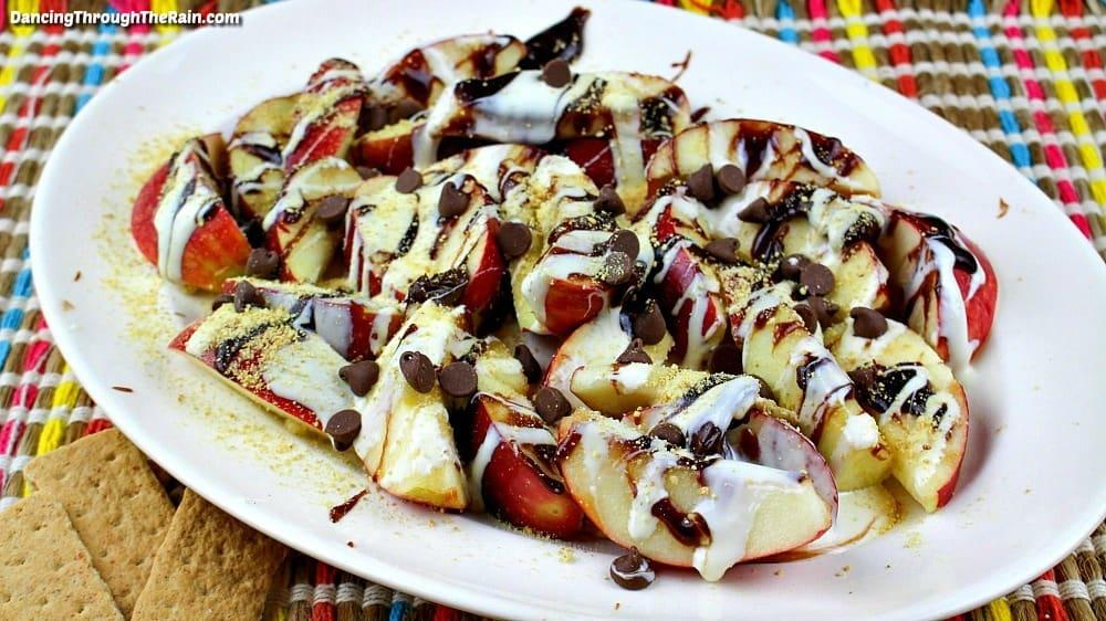 A plate of Apple Smores Nachos next to three graham cracker pieces