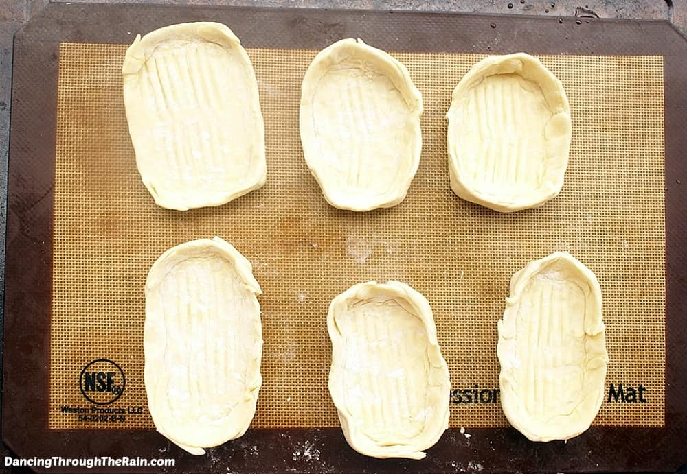 Phyllo dough boats on a baking mat