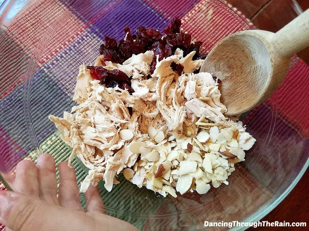 Ingredients for Easy Cranberry Chicken Salad in amixing bowl