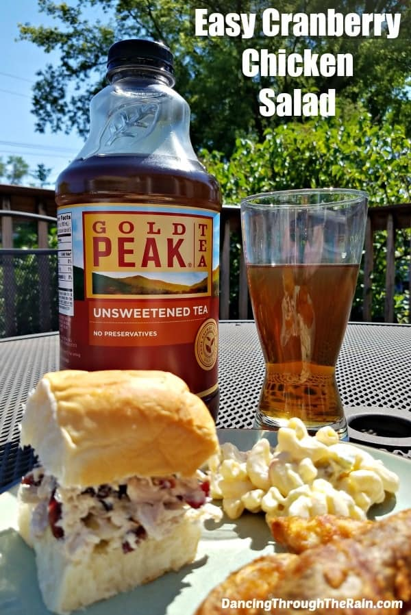 Easy Cranberry Chicken Salad on a bun next to Gold Peak Tea