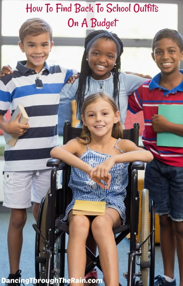 Children standing together with their arms around each other, one girl is in a wheelchair