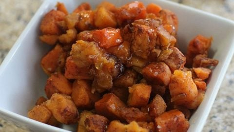 Cinnamon Honey Glazed Sweet Potatoes in a white bowl