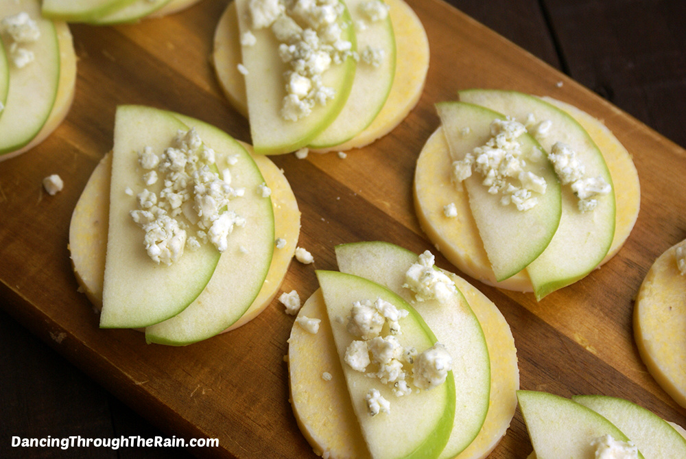Eight Polenta Bites with Apple and Gorgonzola on a wooden cutting board