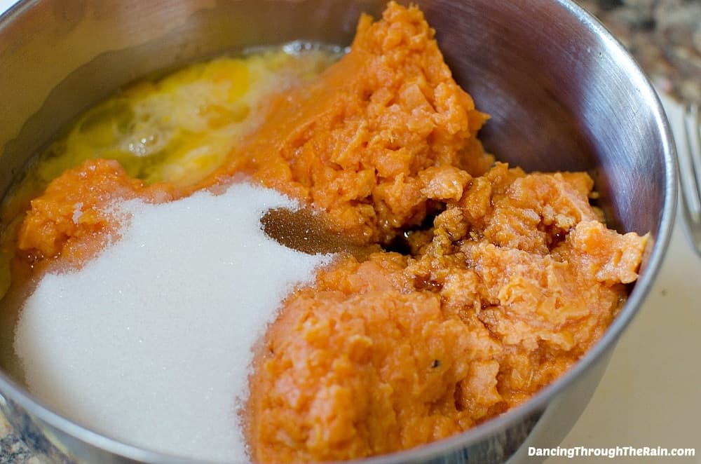 Sweet potatoes, eggs, vanilla, and sugar in a mixing bowl