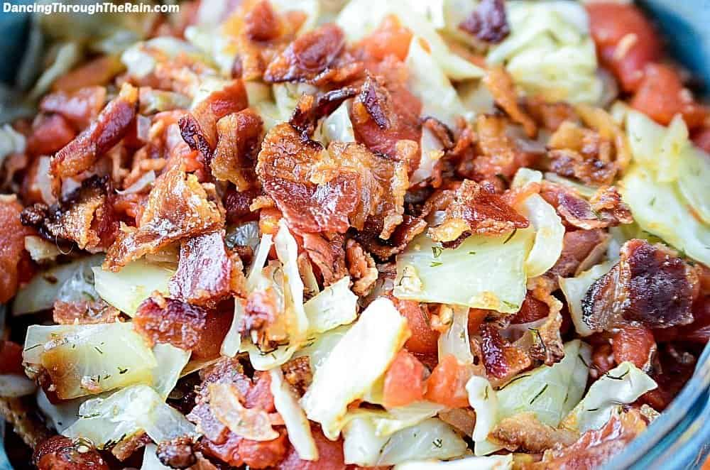 Sauteed cabbage and bacon in a blue bowl