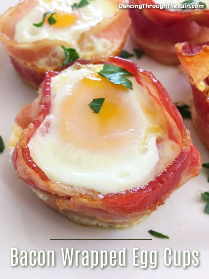 Four Bacon Wrapped Egg Cups On a white plate