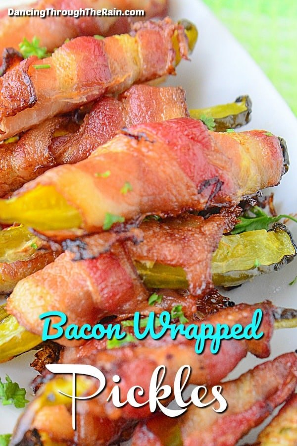A white plate full of bacon wrapped pickles