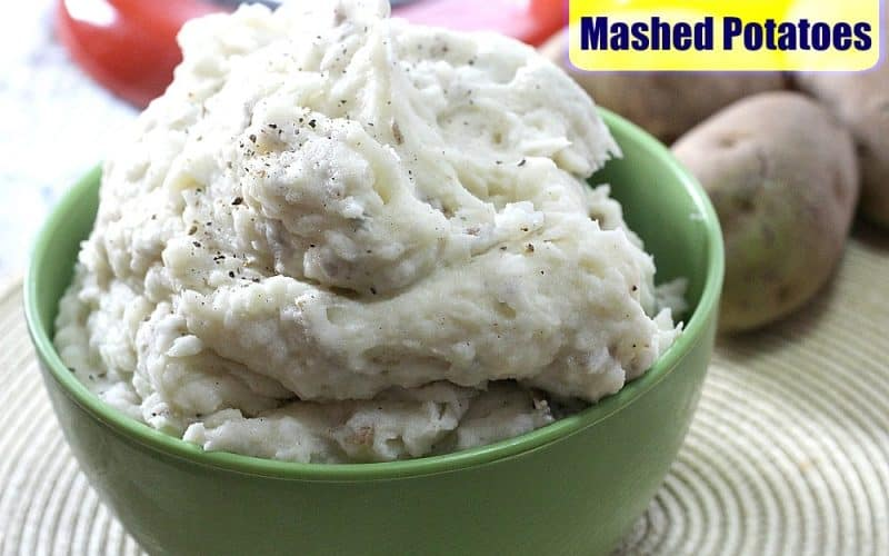 Garlic mashed potatoes in a green bowl