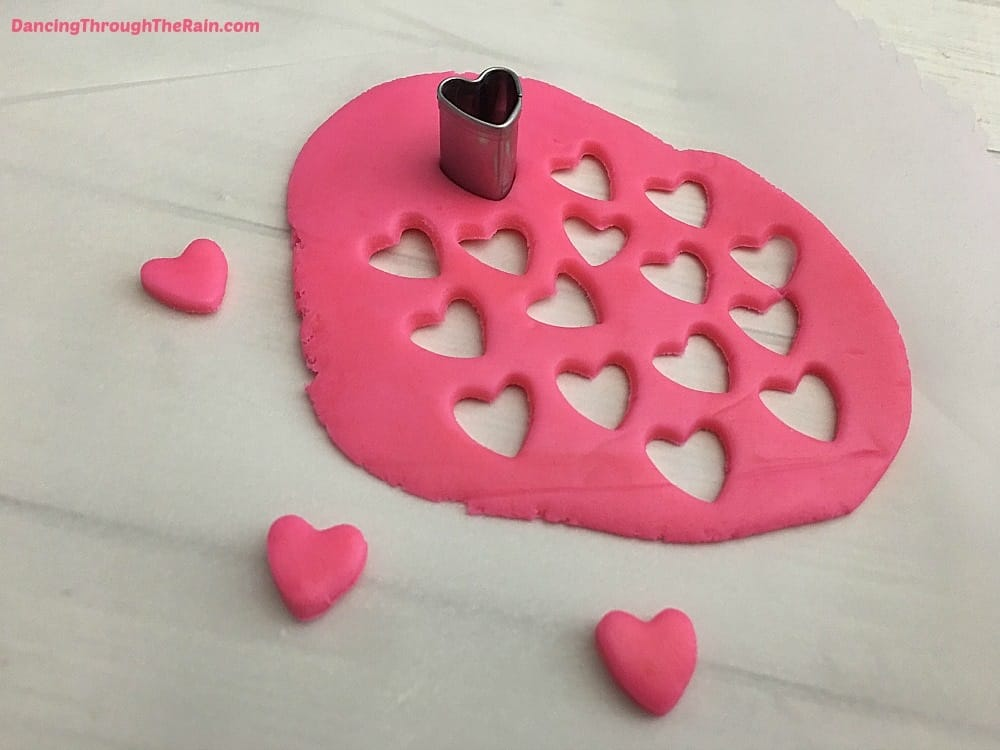 Pink fondant with mini heart shapes cut out