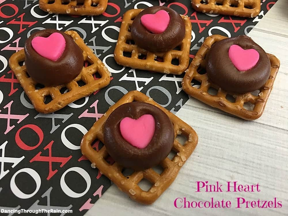 Pink heart chocolate pretzels on Valentine's placemat