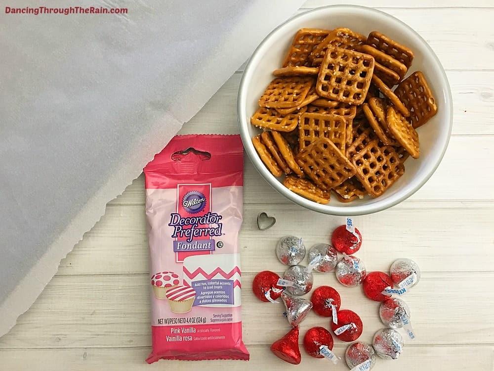Hershey's Kisses, Pink Fondant, Pretzels and Baking Sheet