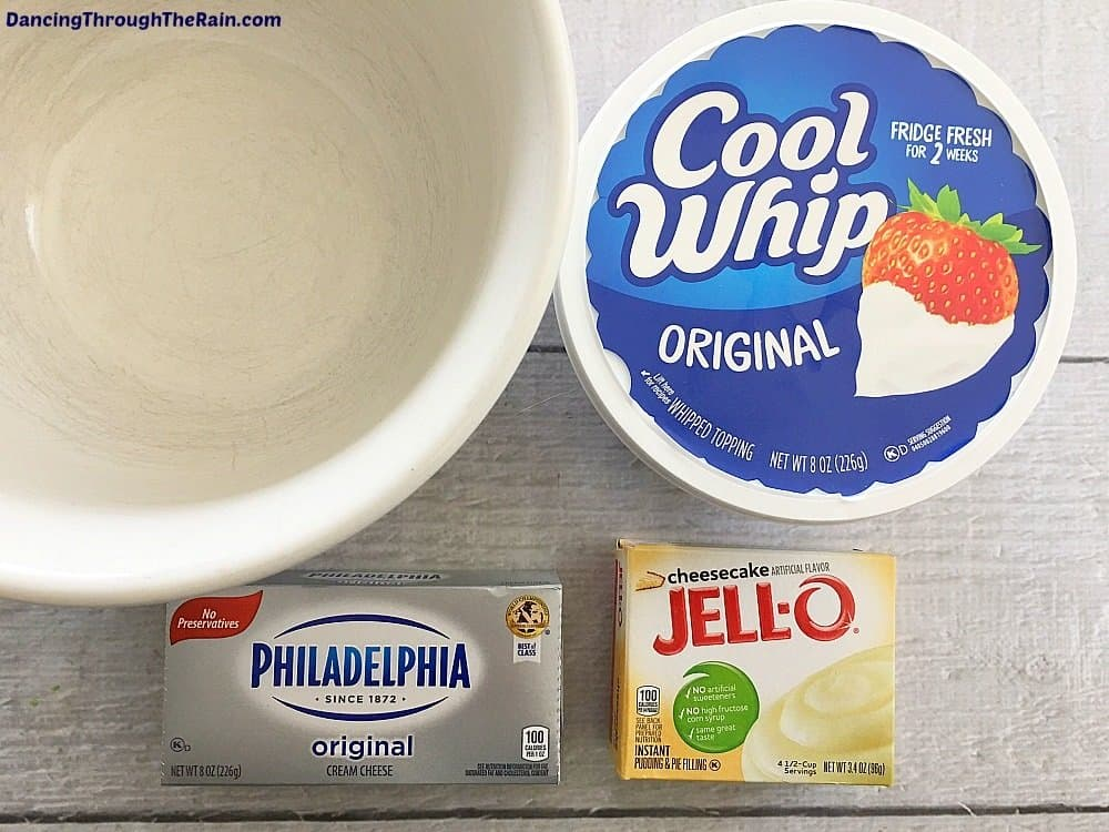 Cool Whip, cream cheese brick and Jell-O instand pudding next to an empty bowl