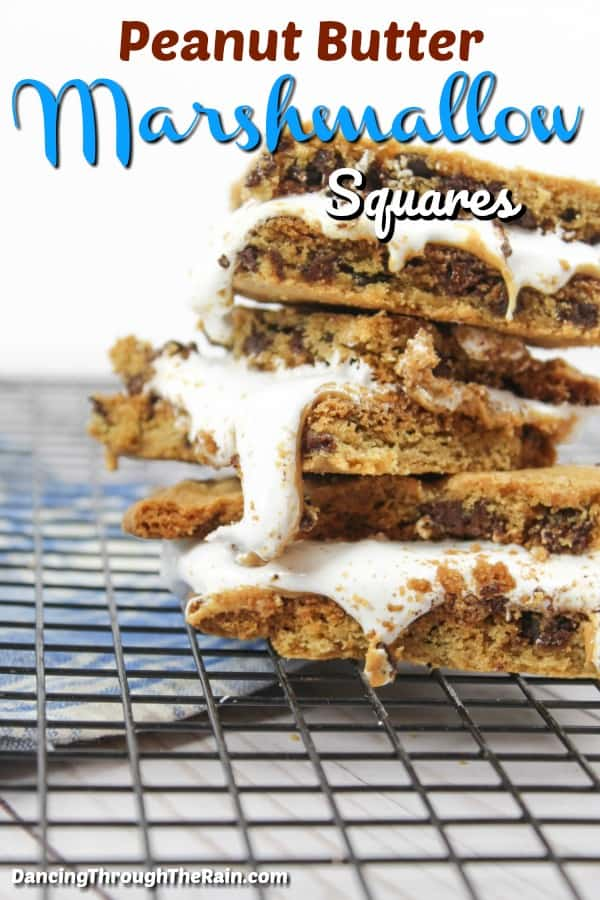 Three peanut butter marshmallow squares on a cookie rack