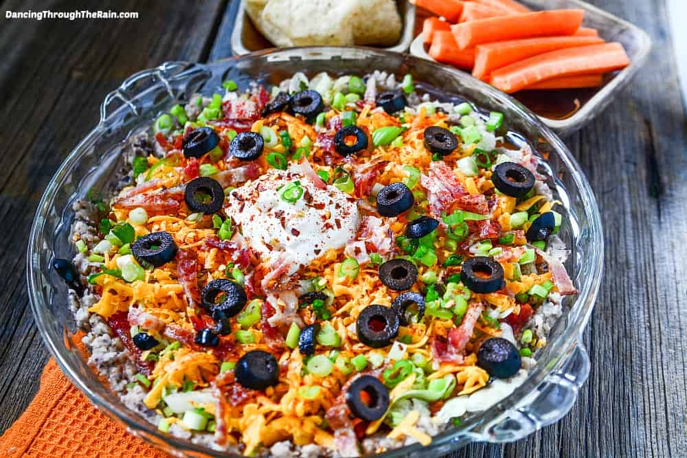 A great black eyed peas recipe that is also an appetizer can be hard to come by, but this is a winner! Take your typical taco dip recipe, turn it on its head and make it a little healthier with black eyed peas!