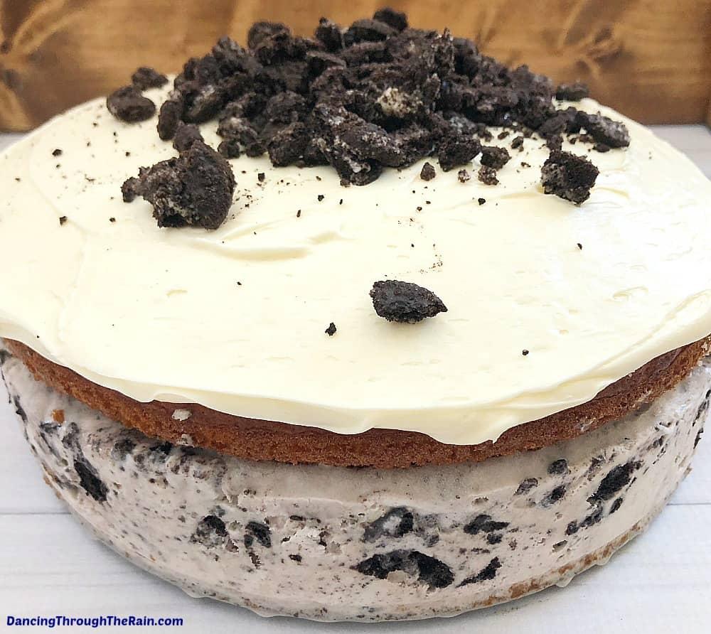 A semi-homemade Oreo Cookie Ice Cream Cake on a white table