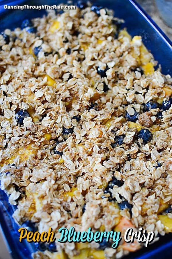 Peach Blueberry Crisp in a clear blue dish