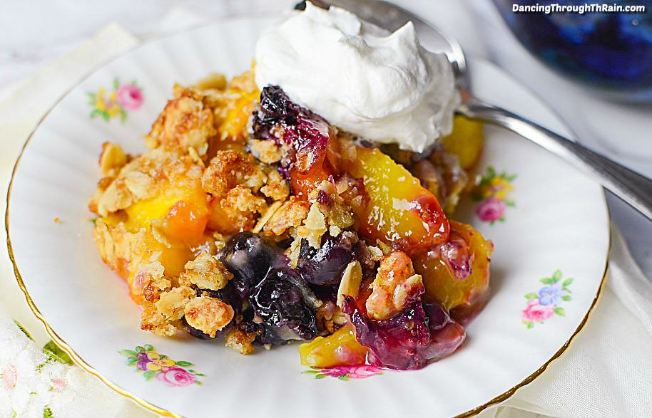 A good peach crisp is the perfect summer dessert for all occasions! Add some blueberries to this easy recipe and you'll have the star of the treats table.