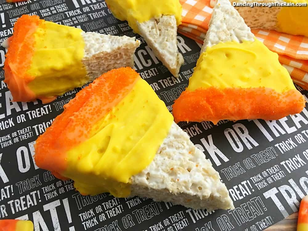 Five Candy Corn Rice Krispie Treats on a Halloween themed placemat with Trick or Treat on it