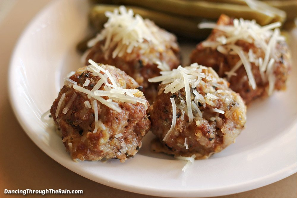 A white plate with Garlic Parmesan Meatballs