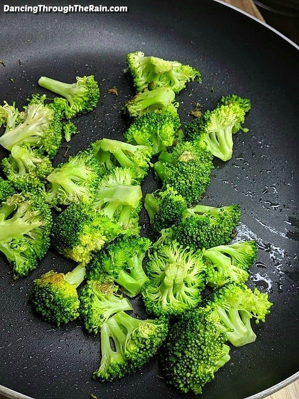 Broccoli frying in a pan