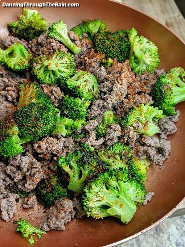 Beef and broccoli with seasonings in a pan