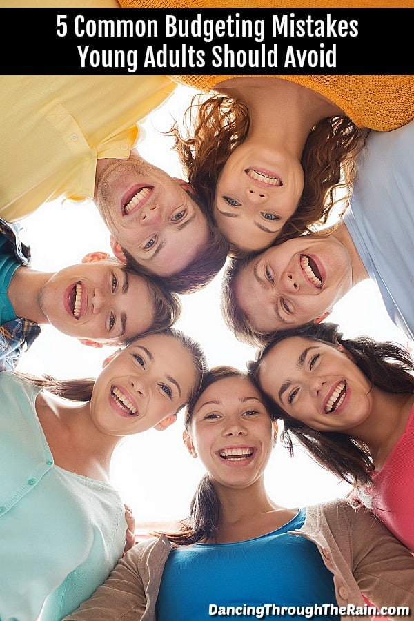 Seven young adults in a circle looking down at the camera