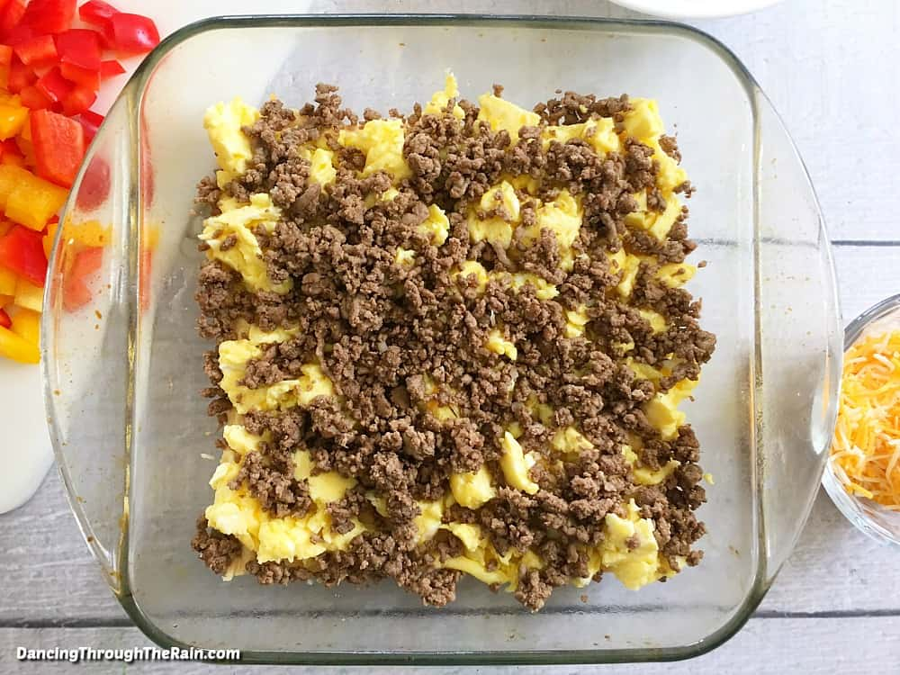 Ground meat, eggs, cheese, and crescent rolls in a baking dish
