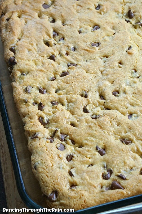 Baked chocolate chip caramel cookie bars in a baking dish
