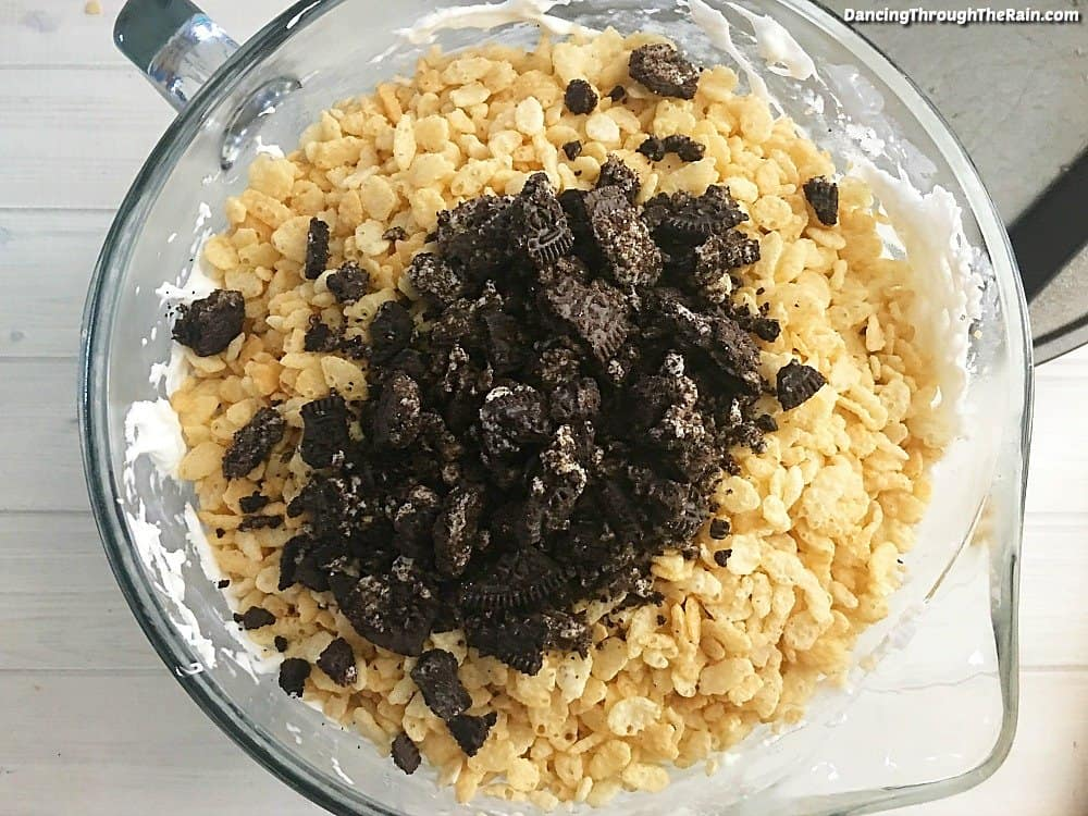 Melted marshmallows and butter with Rice Krispies and Oreos on top