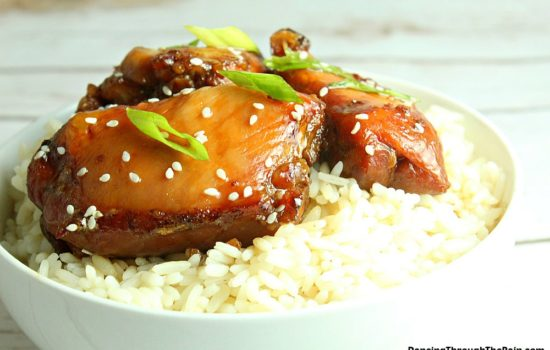 Slow Cooker Mongolian Chicken in a white bowl with rice