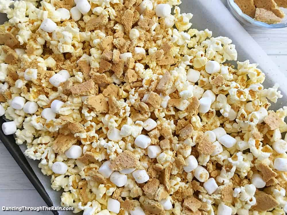 Popcorn, marshmallows and graham crackers on a baking sheet