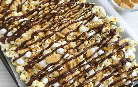 S'mores popcorn on a baking sheet