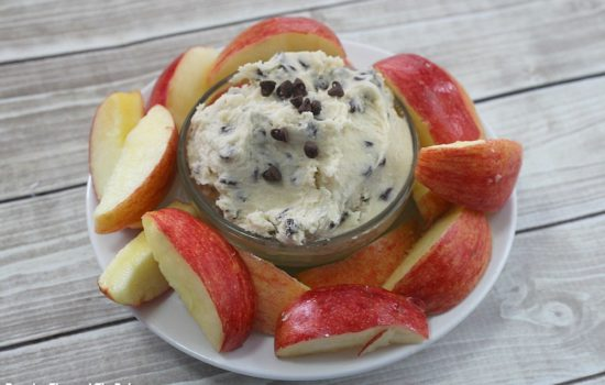 Chocolate Chip Cookie Dip with apple slices around it