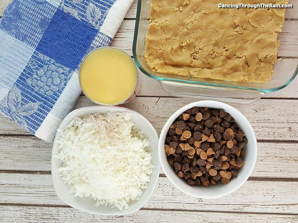 Coconut, Evaporated Milk, chocolate chips and shortbread in a baking dish